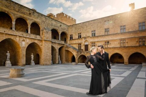 Affluent-couple-in-evening-wear-dancing-in-palace-courtyard