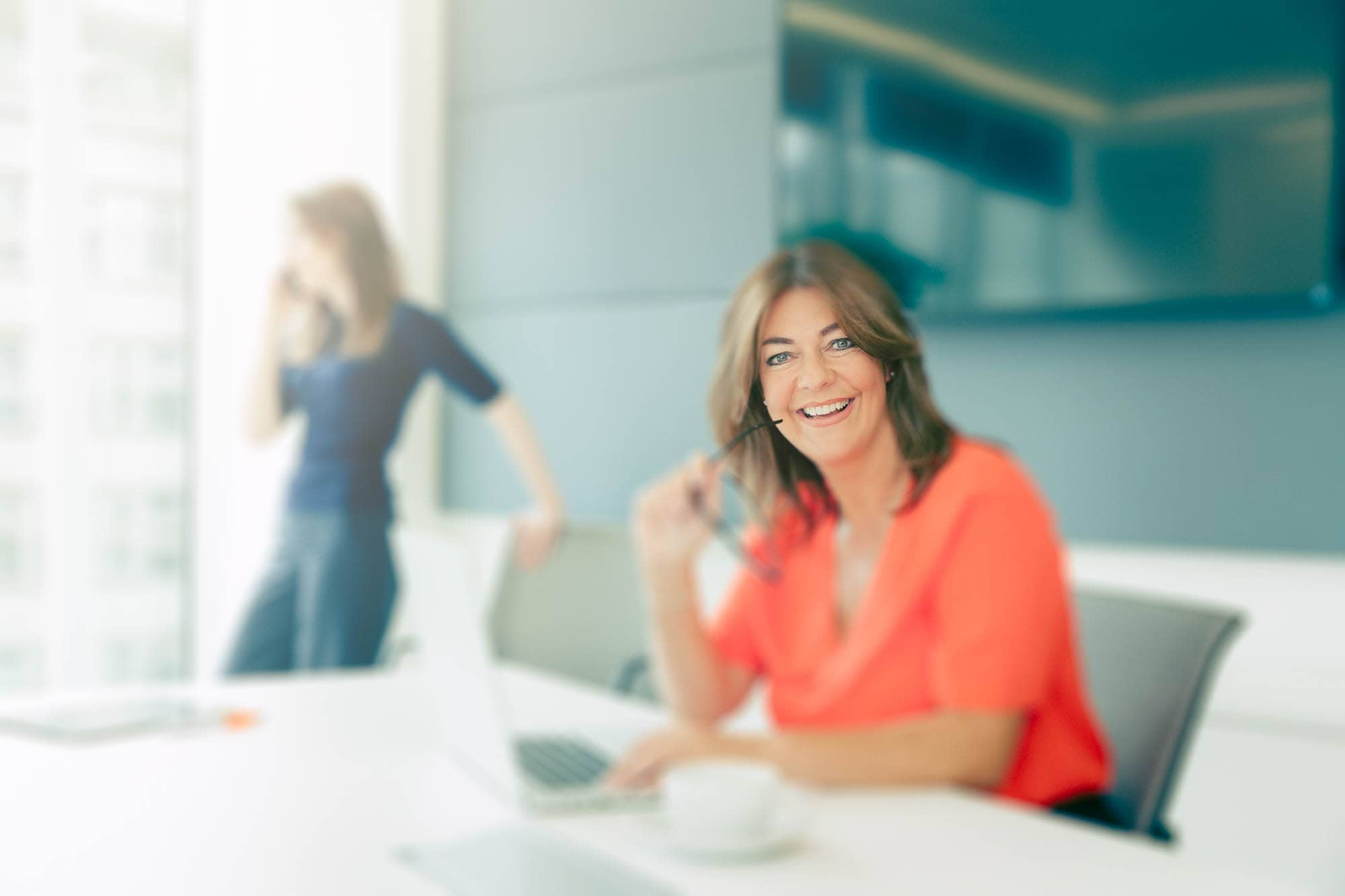 Mimecast Corporate Business Photography Woman At Desk