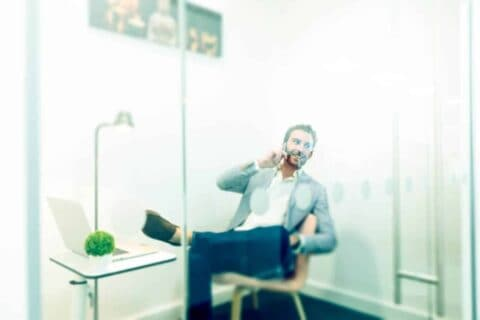 Corporate-photographer-mimecast-man-on-phone-in-glass-cubicle