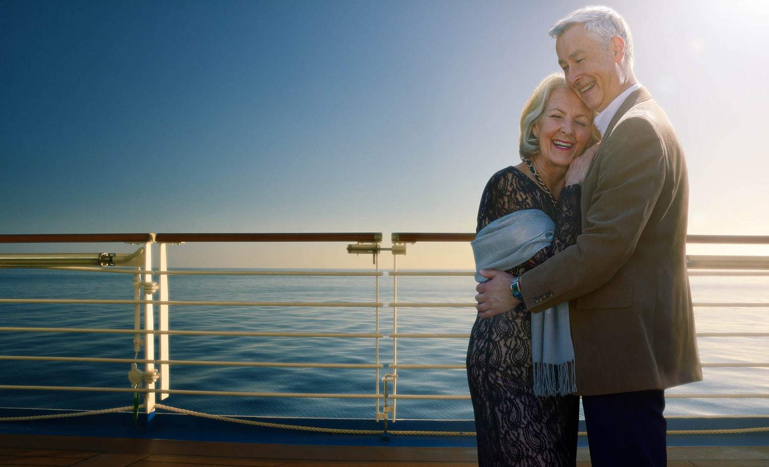 Mature-couple-evening-embracing-cruise-ship-lifestyle-photography