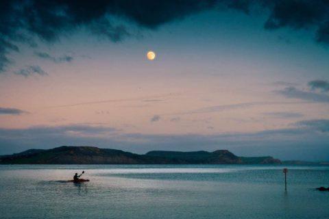 Kayak-at-dusk-lyme-regis