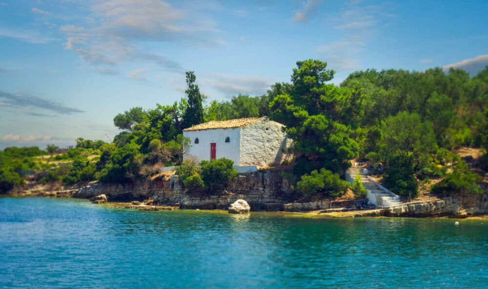 White Greek Chapel Surrounded By Blue Sea, Paxos Greece